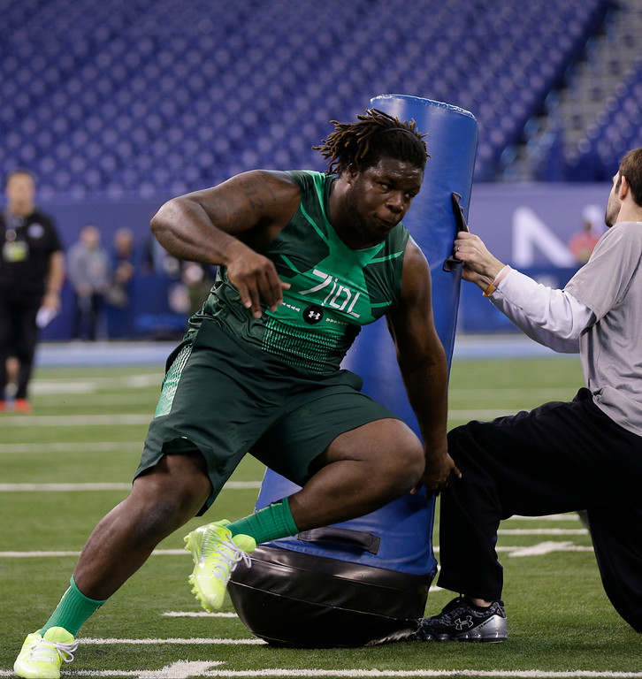 . Texas defensive lineman Malcom Brown runs a drill at the NFL football scouting combine in Indianapolis, Sunday, Feb. 22, 2015. (AP Photo/David J. Phillip)