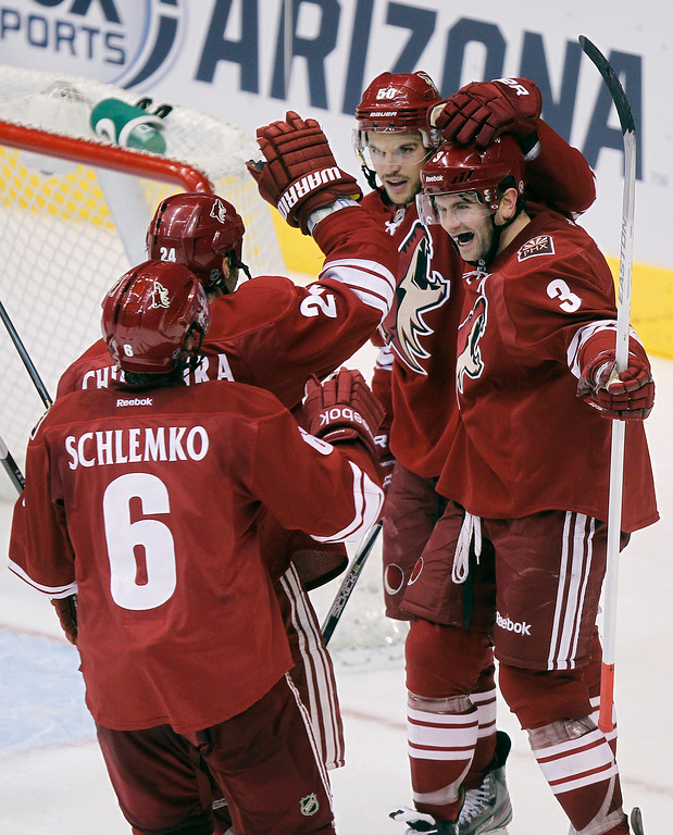 . Phoenix Coyotes defenseman Keith Yandle (3) is congratulated by teammates, from left, David Sclemko, Kyle Chipchura, Antoine Vermette after Yandle scored his second goal of the game against the Los Angeles Kings in the third period of an NHL hockey game Tuesday, April 2, 2013, in Glendale, Ariz. The Coyotes won 3-1. (AP Photo/Paul Connors)