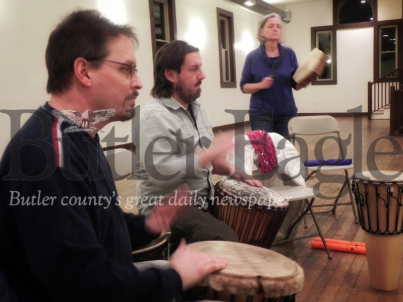 Ellwood City resident Rob Kinney adds his own rhythm to the beat played by the Harmony Drum and Dance Circle. Photo by Gabriella Canales.