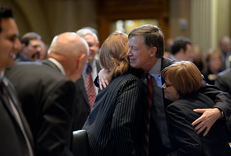 ". Governor Hickenlooper gave hugs and shook hands on his way back to his office after his speech. Governor John Hickenlooper gave his third State of the State address before a packed audience in the House Chambers of the State Capitol on January 10th, 2013.  The Governor took on the issue of gun regulations in his State of the State speech  calling for universal background checks for all gun purchases. In his third such address to the legislature, Hickenlooper, a Democrat, also called for a moment of silence in the House chamber to remember the victims of the Aurora shooting massacre and said Coloradans ""have an obligation to prevent similar tragedies.\"" The mayor, police chief and fire chief of Aurora were present for the governor\'s annual address.  -  Helen H. Richardson, The Denver Post"