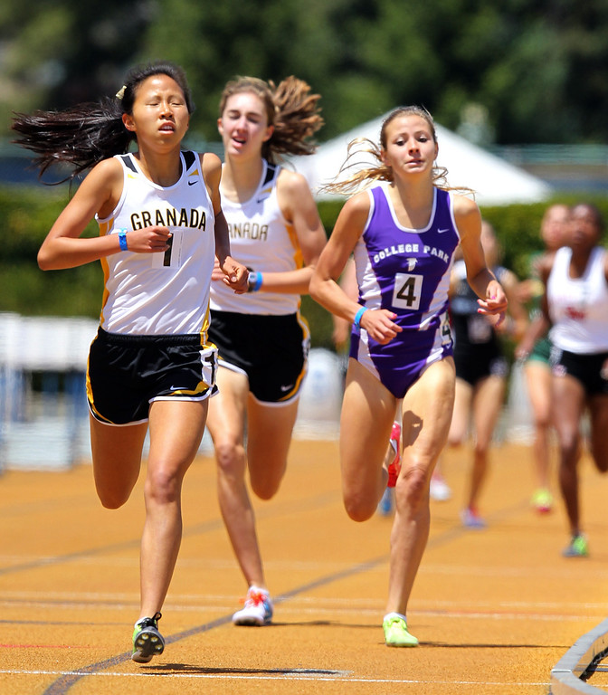 . Granada\'s Maryann Gong wins the girls 1600 meter final ahead of, from left, Granadas\' Megan McCandless and College Park\'s Kendall Stuscavage at the North Coast Section Meet of Champions at Cal\'s Edwards Stadium in Berkeley, Calif., on Saturday, May 25, 2013. Stuscavage placed second and McCandless placed third. (Anda Chu/Bay Area News Group)
