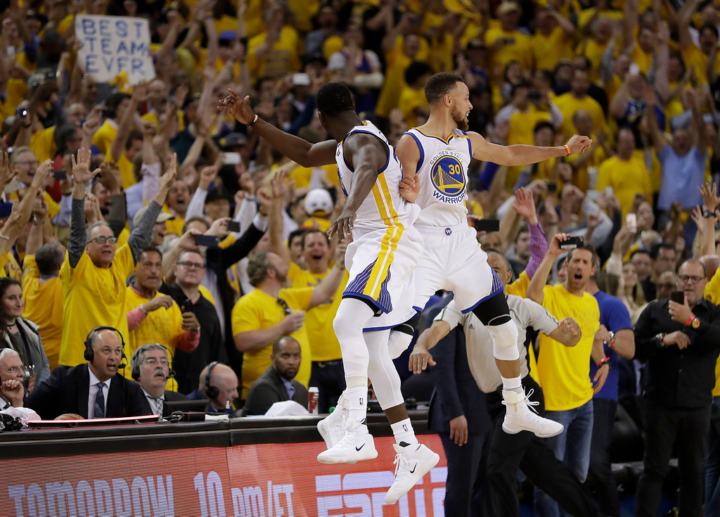 . Golden State Warriors forward Draymond Green, left, and guard Stephen Curry (30) celebrate during the second half of Game 5 of basketball\'s NBA Finals against the Cleveland Cavaliers in Oakland, Calif., Monday, June 12, 2017. The Warriors won 129-120 to win the NBA championship. (AP Photo/Marcio Jose Sanchez)