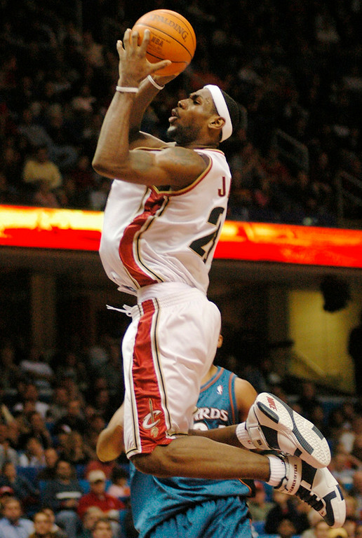 . Michael Blair/News-Herald Cavs\' Lebron James glides in for a slam dunk during the first half of Saturday\'s game at Gund Arena.