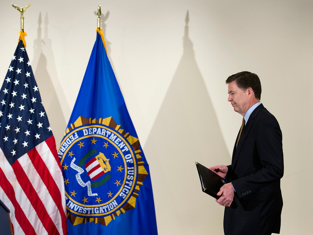. FBI Director James Comey walks to the podium to make a statement at FBI Headquarters in Washington, Tuesday, July 5, 2016. Comey said the FBI will not recommend criminal charges in its investigation into Hillary Clinton\'s use of a private email server while secretary of state. (AP Photo/Cliff Owen)