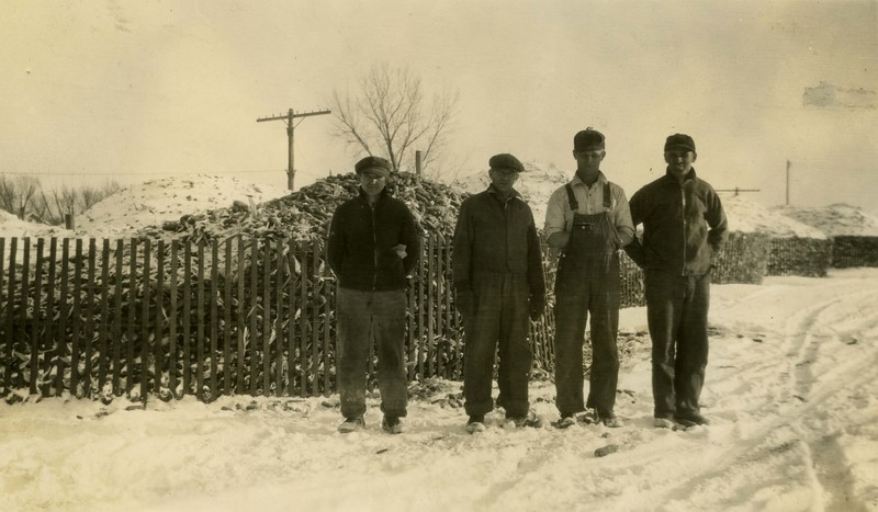 JB158.  Unknown men – Corn piles – 1935.jpg