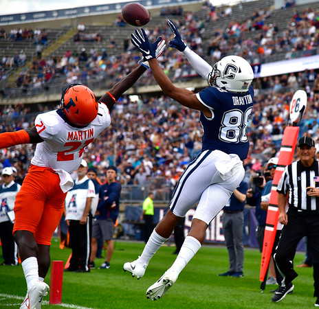 9/7/2019 Mike Orazzi | Staff UConn's Matt Drayton (88) and University of Illinois's Jartavius Martin (21) during Saturday's football game at Rentschler Field in East Hartford.