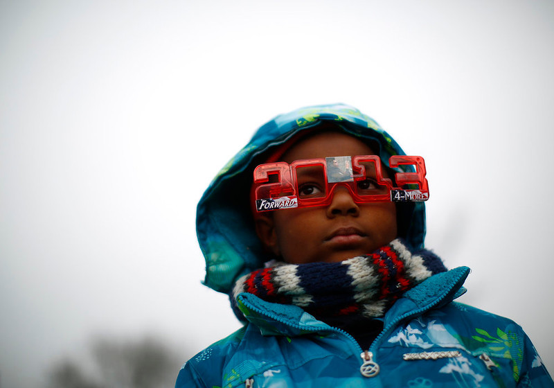 . A boy listens on the National Mall during the 57th inauguration ceremonies for U.S. President Barack Obama and Vice President Joe Biden on the West front of the U.S. Capitol, in Washington January 21, 2013. REUTERS/Eric Thayer