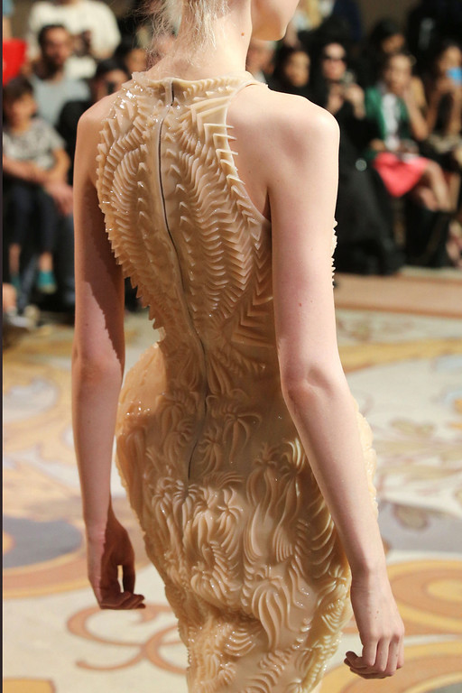 . A model wears a creation by Dutch designer Iris van Herpen for the Haute Couture Fall-Winter 2013-2014 collection, Monday, July 1, 2013 in Paris.  (AP Photo/Michel Euler)