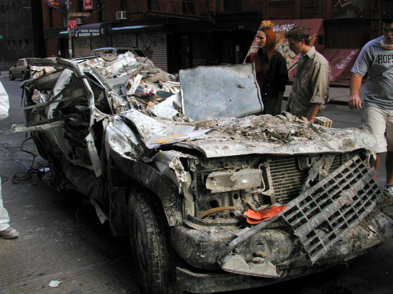 We gazed on in a strange fascination at the crushed cars that littered my neighborhood.