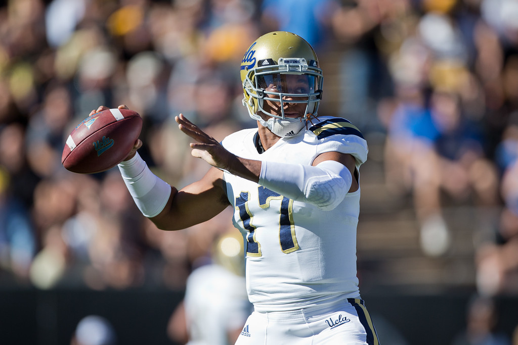 . BOULDER, CO - OCTOBER 25:  Quarterback Brett Hundley #17 of the UCLA Bruins throws a pass during the first quarter against the Colorado Buffaloes at Folsom Field on October 25, 2014 in Boulder, Colorado. (Photo by Justin Edmonds/Getty Images)