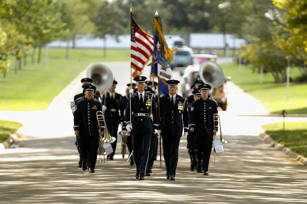. A U.S. Air Force Honor Guard leads members of the U.S. Air Force Band at the beginning of Captain David Anthony Wisniewski\'s burial service at Arlington National Cemetery August 23, 2010 in Arlington, Virginia. Originally from Moville, Iowa, the Air Force captain, 31, was the pilot of a Black Hawk helicopter that was shot down during a rescue mission in Afghanistan on June 9 and died of his injuries on July 2. Wisniewski is credited with saving more than 240 soldiers in seven tours of duty in Iraq and Afghanistan, 40 of which were saved in his final rescue mission in June. He was awarded the Purple Heart on June 23.  (Photo by Chip Somodevilla/Getty Images)