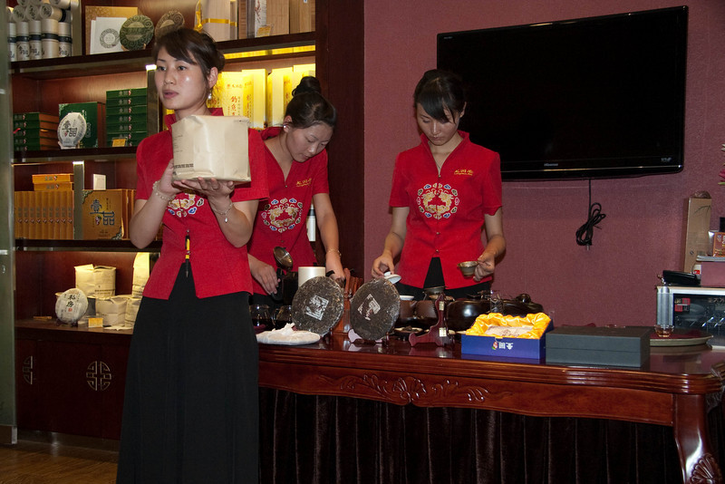 Tea-drinking is a big deal and big business in China.  The ladies in the back are preparing different kinds of tea for us try.  They use hot water to rinse off the glass pots twice before they make the tea.