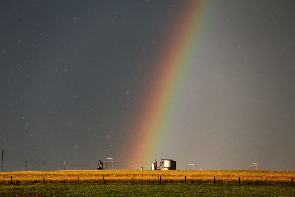 . A rainbow can be seen north of El Reno, OK near U.S. Highway 81 after a tornado touched down near El Reno, Okla., Friday, May 31, 2013, causing damage to structures and injuring travelers on Interstate 40. I-40 has been closed after severe weather rolled through the area. (AP Photo/Omaha World-Herald, Chris Machian)
