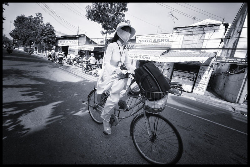 we saw this lady riding a bike in a Ao Dai - the classic woman's wear of Vietnam