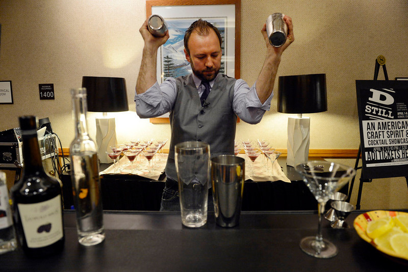""". Brian Melton, of the Colorado Bartenders Guild, mixes up a batch of the \""""DSTILL Cocktail\"""" during the American Distilling Institute\'s 10th Annual Craft Spirits Conference & Vendors Expo at the downtown Sheraton in Denver, CO April 02, 2013. DSTILL  expects more than 900 visitors during the weeklong celebration, making it the country�s largest rally of independent distillers.   (Photo By Craig F. Walker/The Denver Post)"""
