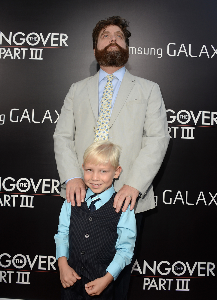 """. Actors Zach Galifianakis and Grant Holmquist arrive at the premiere of Warner Bros. Pictures\' \""""Hangover Part 3\"""" on May 20, 2013 in Westwood, California.  (Photo by Kevin Winter/Getty Images)"""