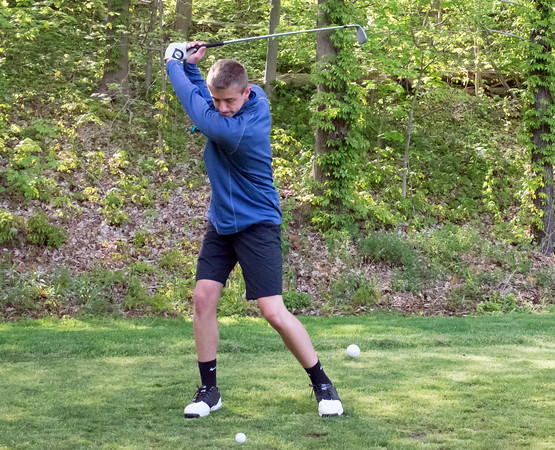 05/10/18 Wesley Bunnell | Staff New Britain golf defeated Bristol Eastern 212-219 at Stanley Golf Course on Thursday afternoon. Bristol Eastern's Drew Fries with his tee shot on the eighth hole.