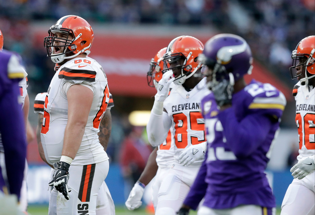 . Cleveland Browns guard Spencer Drango, left, shouts out during the first half of an NFL football game against Minnesota Vikings at Twickenham Stadium in London, Sunday Oct. 29, 2017. (AP Photo/Matt Dunham)