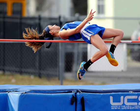 4/5/2018 Mike Orazzi   Staff Plainville High School's Samantha Lozefski in high jump at Plainville High School Thursday afternoon.