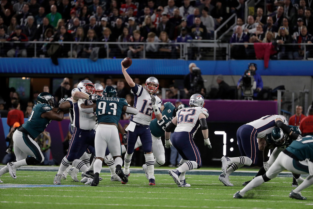 . New England Patriots\' Tom Brady (12) passes during the first half of the NFL Super Bowl 52 football game against the Philadelphia Eagles Sunday, Feb. 4, 2018, in Minneapolis. (AP Photo/Matt Slocum)