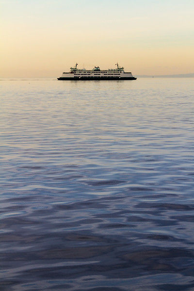 View of ferry boat sailing at dusk