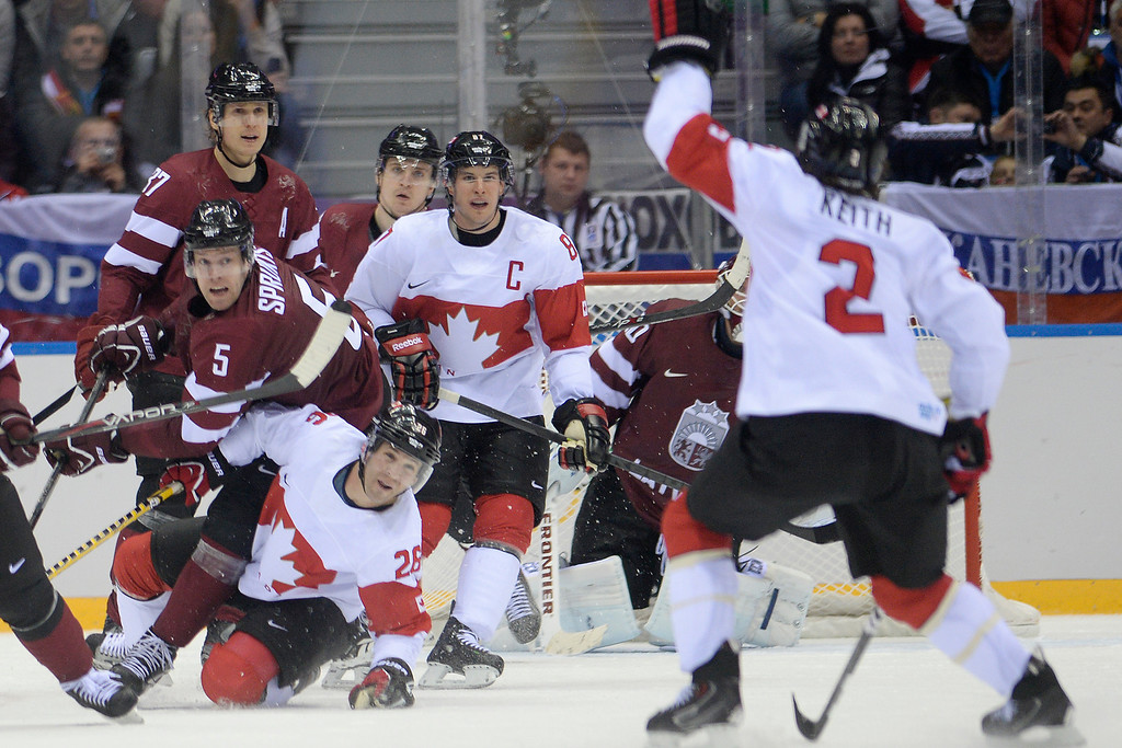 . SOCHI, RUSSIA - FEBRUARY 19: Players from Latvia and Canada watch as Duncan Keith (2) of the Canada catches the puck during the second period of men\'s hockey action. Sochi 2014 Winter Olympics on Wednesday, February 19, 2014 at Bolshoy Ice Arena. (Photo by AAron Ontiveroz/ The Denver Post)