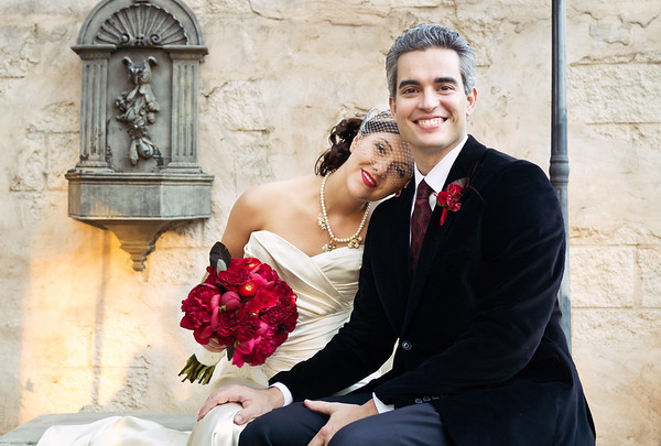 Happy bride and groom with red roses