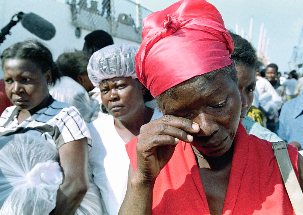 . Viviane Sujour, 28, cries upon arrival at a Port-au-Prince dock, Thursday, Jan. 21, 1993 after the U.S. Coast Guard cutter Campbell picked up 163 Haitian refugees last Wednesday on a sailboat. The Coast Guard says the sailboat was picked up in rough seas Wednesday after setting out Tuesday form Haiti. Sujour says she is crying because she has no work to feed her family and she ended up returning from the home she was fleeing. (AP Photo/Michael Stravato)