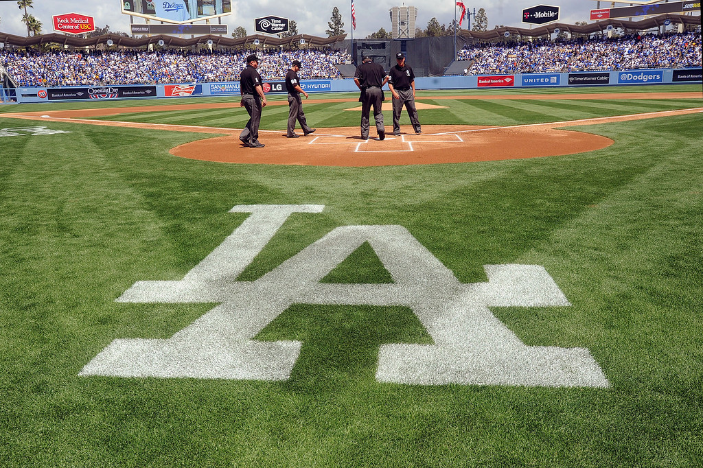 . MLB umpires take the field on opening day at Dodger Stadium April 1, 2013.  The Dodgers hosted the San Francisco Giants.(Andy Holzman/Staff Photographer)