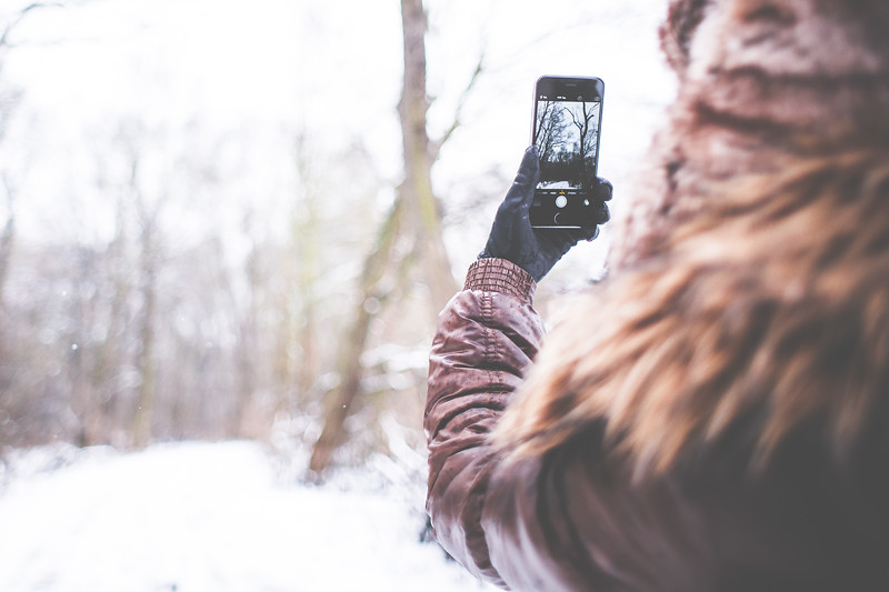 girl-shooting-with-her-iphone-6-in-winter-picjumbo-com.jpg