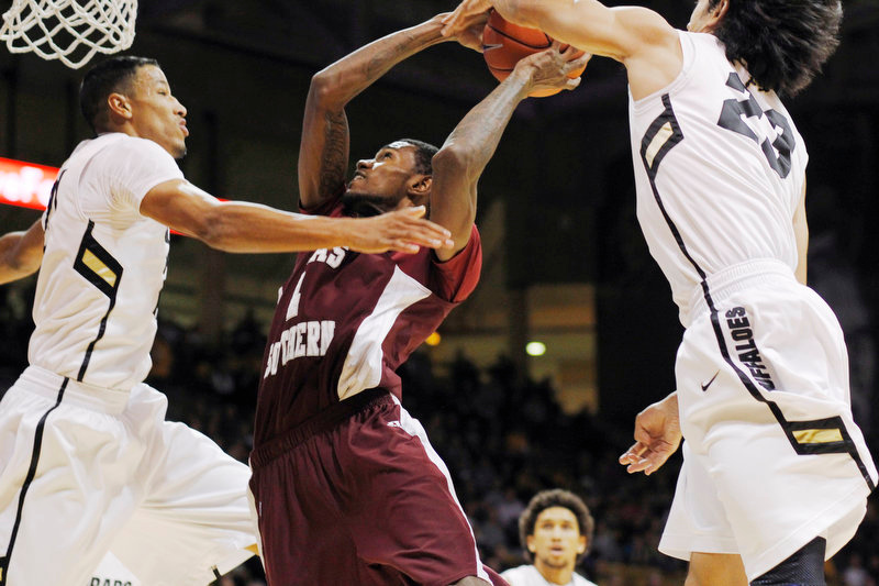 . Texas Southern forward Fred Sturdivant, center, has his shot blocked by Colorado guard Sabatino Chen, right, as guard Andre Roberson, left, blocks the path to the rim in the first half of an NCAA college basketball game in Boulder, Colo., on Tuesday, Nov. 27, 2012. (AP Photo/David Zalubowski)
