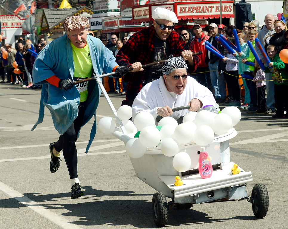 . Maribeth Joeright/MJoeright@News-Herald.com<p> The Maple Marauders bathtub race team comprised of Kevin Morgan at the wheel, Bob Baird, left, and Drew Vargo push their way to the finish line during the annual event at 85th annual Geauga County Maple Festival on Chardon Square, April 27, 2014. The Maple Marauders took best of show for the creative costumes.