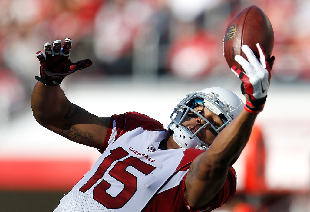 . Arizona Cardinals wide receiver Michael Floyd (15) catches a pass against the San Francisco 49ers during the first half of an NFL football game in Santa Clara, Calif., Sunday, Dec. 28, 2014. (AP Photo/Tony Avelar)