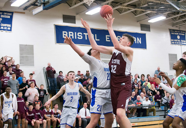 02/24/20 Wesley Bunnell | StaffrrBristol Central's Donovan Clingan (32) reaches for a rebound guarded by BE's Otero (21).