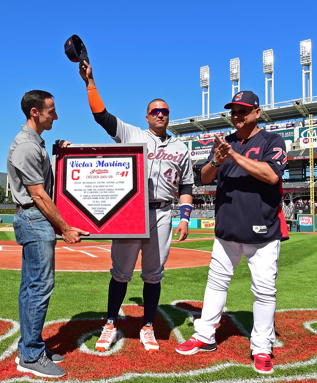 . Detroit Tigers\' Victor Martinez, center, waves to fans acknowledging his retirement during a pregame ceremony before a baseball game between the Cleveland Indians and Detroit Tigers, Saturday, Sept.15, 2018, in Cleveland. (AP Photo/David Dermer)