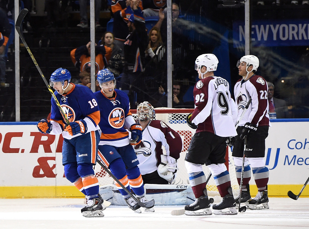 . New York Islanders center Ryan Strome (18) and center Anders Lee (27) celebrate Strome\'s goal as Colorado Avalanche goalie Semyon Varlamov (1), left wing Gabriel Landeskog (92) and defenseman Zach Redmond (22) react in the third period of an NHL hockey game at Nassau Coliseum on Tuesday, Nov. 11, 2014, in Uniondale, N.Y. The Islanders won 6-0. (AP Photo/Kathy Kmonicek)