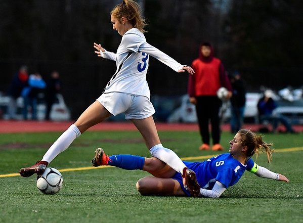 11/23/2019 Mike Orazzi | Staff Southington High School's Emma Panarella (7) and Glastonbury's Jaci Budaj (3) during the Class LL Girls State Soccer Tournament at Veterans Stadium in New Britain Saturday evening. Glastonbury won 1-0.