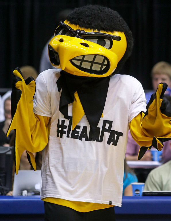 ". ""Herky,\"" the Iowa mascot, wears a T-shirt supporting Pat McCaffery, son of Iowa head coach Fran McCaffery, at halftime of a first-round game against Tennessee in the NCAA college basketball tournament on Wednesday, March 19, 2014, in Dayton, Ohio. Coach McCaffery flew home to be with his 13-year-old son who had a tumor removed Wednesday morning and then flew back to Dayton for their game against Tennessee. (AP Photo/Al Behrman)"