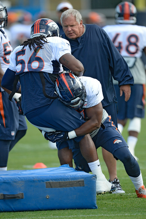 . Denver Broncos outside linebacker Corey Nelson (47) runs through tackling drills with Denver Broncos outside linebacker Nate Irving (56) on day 12 of the Denver Broncos 2014 training camp August 5, 2014 at Dove Valley. (Photo by John Leyba/The Denver Post)