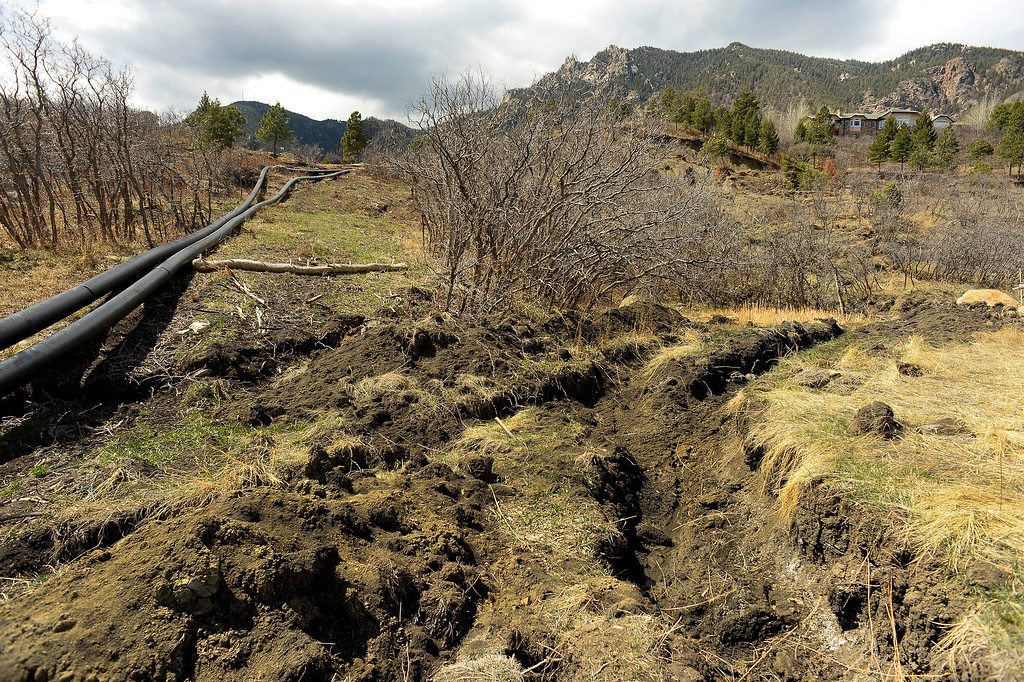 . Temporary water lines, left, were needed to replace existing water lines that were exposed and destroyed by a recent landslide above the  Broadmoor Mountain Golf Course and homes in the area  on April 11, 2016 in Colorado Springs, Colorado. The landslide is slowly creeping down towards homes and the golf course.  200 homeowners in Colorado Springs have applied for federal bailouts because their homes are being eaten up by collapsing expansive soil that is part of an ancient and massive landslide area.   It is a problem that city officials have known about since the mid-1990\'s when city planners approved developments on what geologists have called some of the most unstable geology on the front range.  (Photo by Helen H. Richardson/The Denver Post)