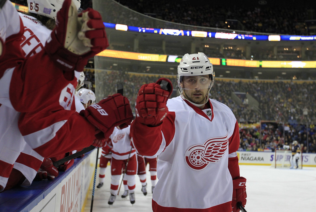 . Detroit Red Wings\' Tomas Tatar is congratulated after scoring during second period action of an NHL hockey game, Sunday, Nov. 2, 2014, in Buffalo, N.Y. (AP Photo/The Buffalo News, Harry Scull Jr)