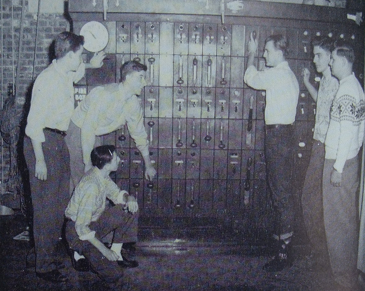 The stage crew mans the massive theatrical lighting console in this 1956 photo taken at the old Union High School which is now Burnet Middle School.