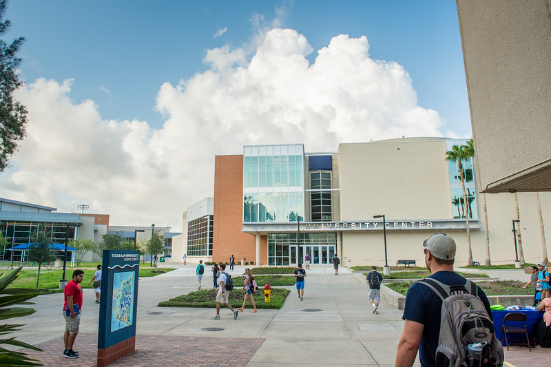 Students make their way to their destinations in the morning, passing by the UC north entrance.