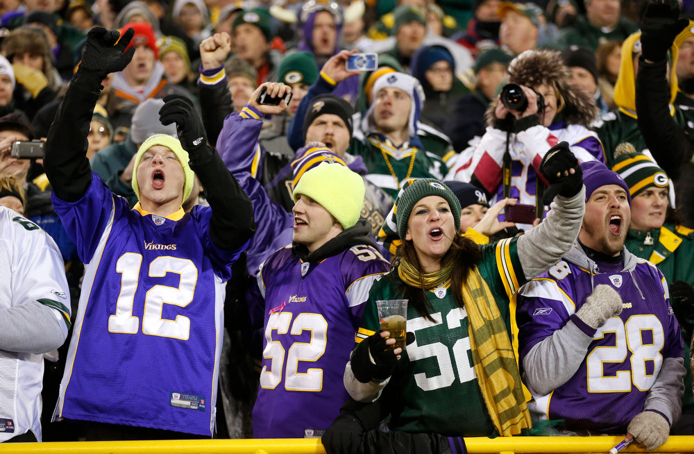 Description of . Fans cheer during the first half of an NFL wild card playoff football game between the Green Bay Packers and the Minnesota Vikings Saturday, Jan. 5, 2013, in Green Bay, Wis. (AP Photo/Jeffrey Phelps)