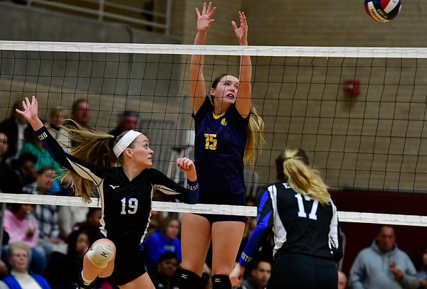 11/14/2018 Mike Orazzi | Staff Bristol Eastern's Amber Blais (19) and Woodstock Academy's Samantha Orlowski (15)during the Class L Semifinal State Girls Volleyball Tournament held at Windsor High School Wednesday night.