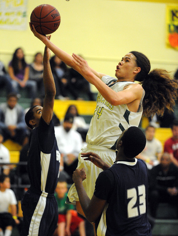 . Narbonne\'s Shailo Leafa (24) takes the ball in against Summit\'s Isaiah Taylor (3) and Quinton Lilley (23) in a first round of Southern California Regional Division II basketball game Tuesday night. Narbonne lost the game in overtime, 72-70. March 08, 2011. Photo by Steve McCrank / Daily Breeze
