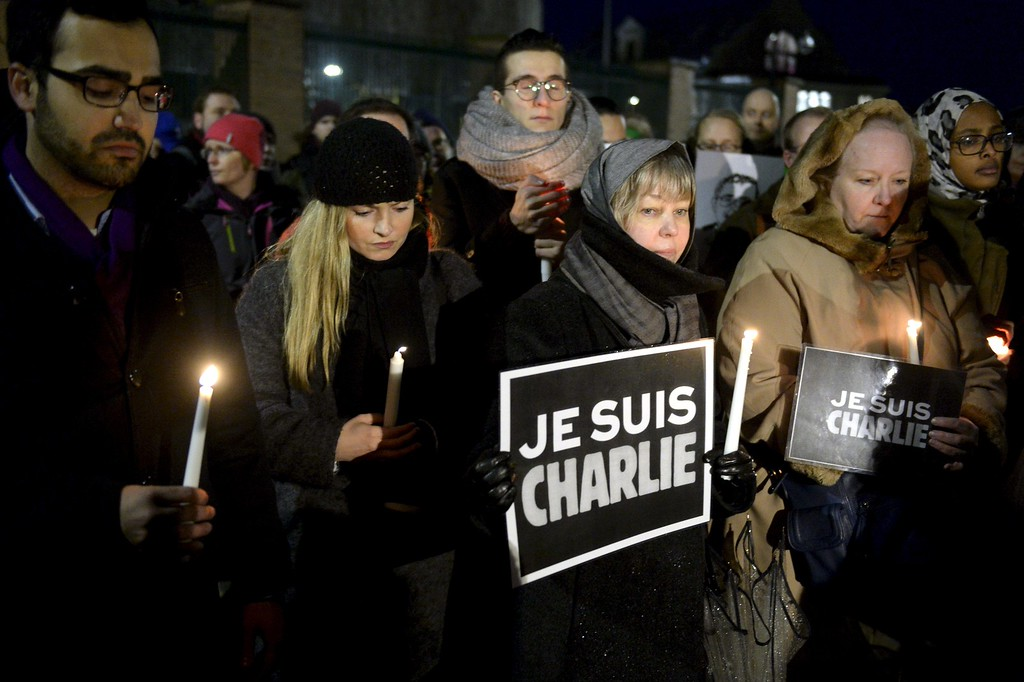 . People hold candles and placards reading \'Je suis Charlie\' (I am Charlie) in front of the French embassy in Helsinki on January 8, 2015, in commemoration of the victims of an attack by armed gunmen on the offices of French satirical newspaper Charlie Hebdo in Paris on January 7, which left at least 12 dead and many others injured.  AFP PHOTO / LEHTIKUVA / JUSSI NUKARI /AFP/Getty Images