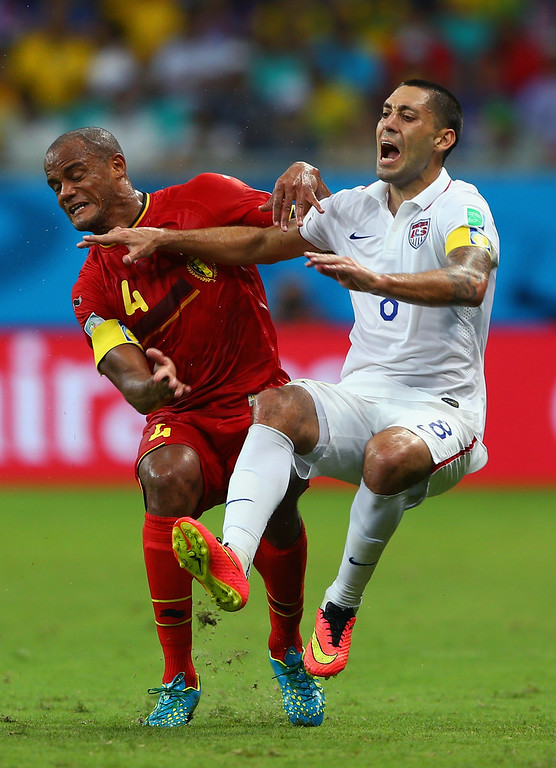 . Vincent Kompany of Belgium challenges Clint Dempsey of the United States resulting in a yellow card during the 2014 FIFA World Cup Brazil Round of 16 match between Belgium and the United States at Arena Fonte Nova on July 1, 2014 in Salvador, Brazil.  (Photo by Michael Steele/Getty Images)