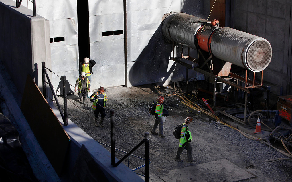 . Construction crews exit the West Portal entrance of the Caldecott Tunnel fourth bore project at the end of their shifts Friday afternoon Jan. 18, 2013 near Oakland, Calif. The long-awaited project expects to open sometime in the latter part of 2013.  (Karl Mondon/Staff)