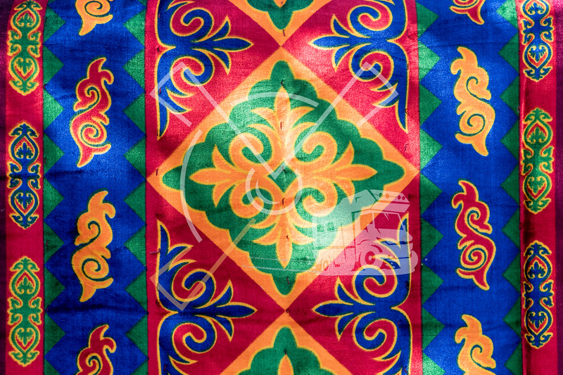 Colourful carpet hanging out in the streets of the old mining city of Ming Kush